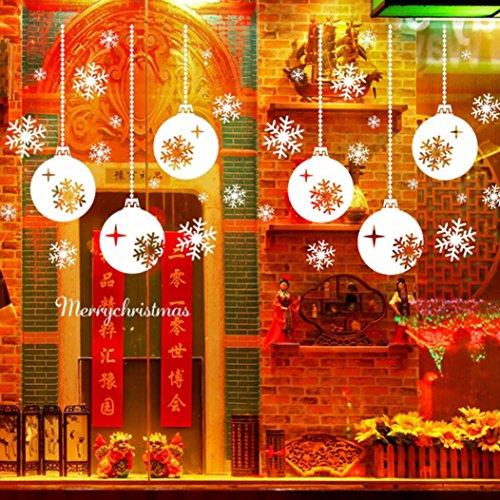 Pared-de-la-Navidad-EtiquetaRETUROM-Feliz-Navidad-creativa-de-la-ventana-del-copo-de-nieve-pegatinas-Dormitorio-Sala-de-la-pared-del-sitio-0-1 Escaparates decorados con vinilos de Navidad